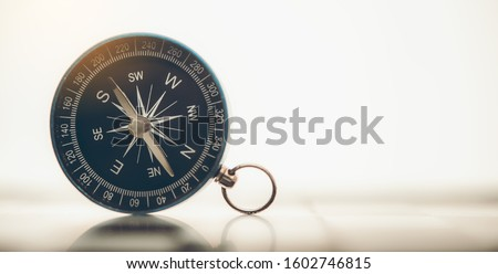 The blue compass is placed on background. Royalty-Free Stock Photo #1602746815