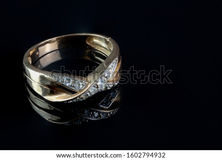 beautiful gold ring with precious stone isolated on black Royalty-Free Stock Photo #1602794932