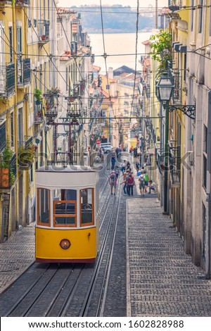 The Bica Funicular (Elevador or Ascensor da Bica) is a famous tourist attraction in Chiado District. Sunny day in summer. Travel and transport concept. Lisbon, Portugal. Europe. #1602828988
