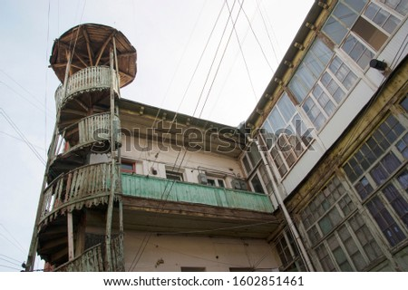 Old Tbilisi. Courtyard in the old town with a broken spiral staircase and lots of clothesline.  #1602851461