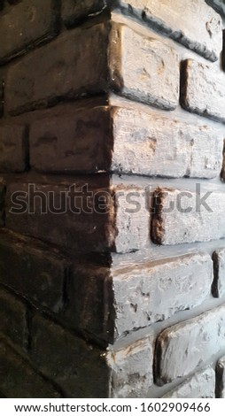 Brick wall. Bricks. Dirty brick surface. Vintage background for postcards #1602909466