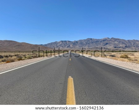 Death Valley road trip empty road Royalty-Free Stock Photo #1602942136