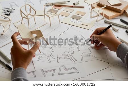 Designer sketching drawing design development product plan draft chair armchair Wingback Interior furniture prototype manufacturing production. designer studio concept .                            #1603001722