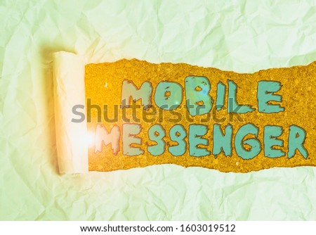 Word writing text Mobile Messenger. Business concept for mobile tool that allows users to send chat messages Cardboard which is torn in the middle placed above a wooden classic table. #1603019512