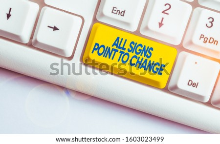 Handwriting text writing All Signs Point To Change. Concept meaning Necessity of doing things differently new vision White pc keyboard with empty note paper above white background key copy space. #1603023499