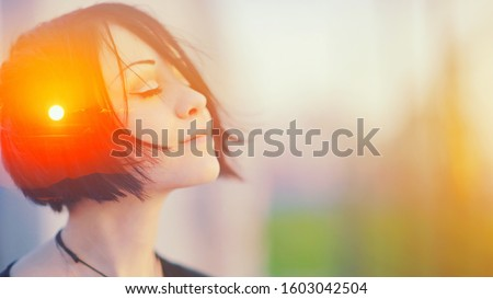 Double multiply exposure portrait of a dreamy cute woman meditating outdoors with eyes closed, combined with photograph of nature, sunrise or sunset. closeup. Psychology freedom power of mind concept #1603042504