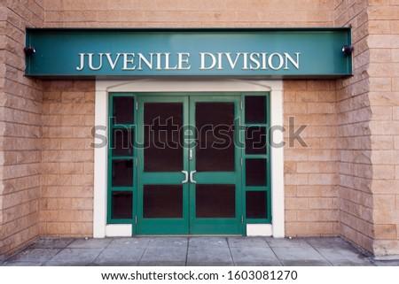 Juvenile police building door entrance. Royalty-Free Stock Photo #1603081270