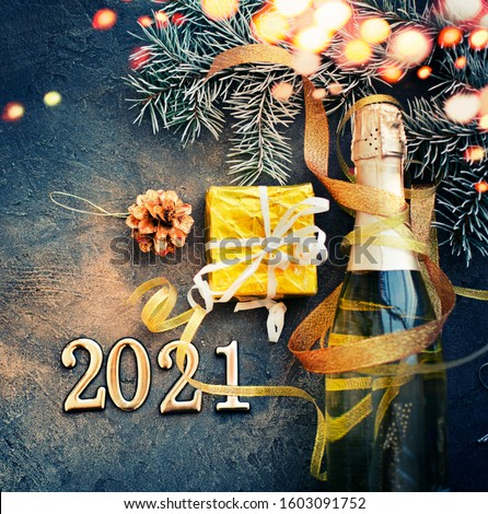 HAPPY NEW YEAR 2021 BACKGROUND OVER DARK STONE TABLE WITH HOLIDAYS DECORATIONS #1603091752