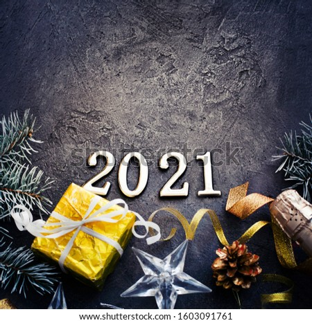 HAPPY NEW YEAR 2021 BACKGROUND OVER DARK STONE TABLE WITH HOLIDAYS DECORATIONS #1603091761
