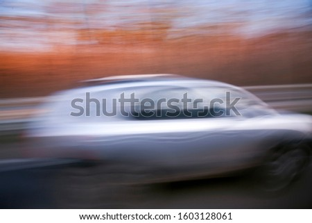 car in fast motion on a deliberately blurred in motion background #1603128061