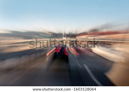 car in fast motion on a deliberately blurred in motion background #1603128064