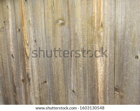 Brownish gray weathered wood panel fence #1603130548