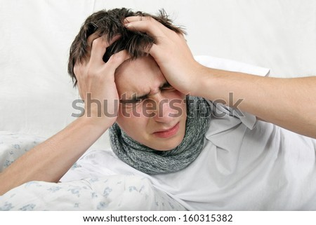 Sick Young Man feels Headache and lying on the Bed #160315382