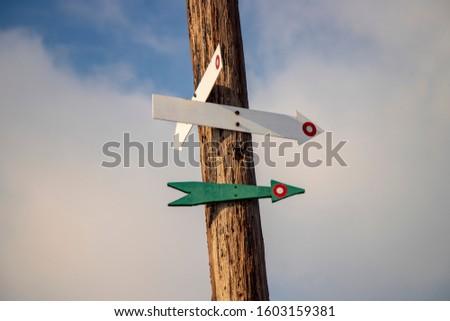 Hiking arrows in the shape of an arrow on a tree #1603159381