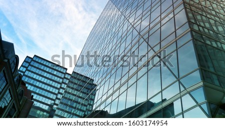 Pattern and reflections in several buildings during a sunny day in Europe.  #1603174954