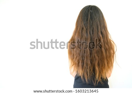 Back view of woman with her damaged split ended hair. Hair damage is risk for further damage and breakage. It may also look dull or frizzy and be difficult to manage. #1603213645