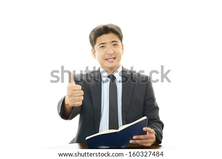 Happy business man showing thumbs up sign #160327484
