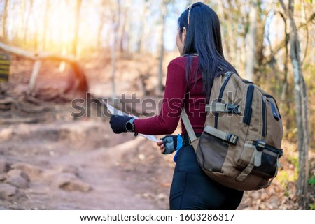 woman traveler walking in the forest and enjoying for beautiful view of nature on holiday.adventure concept. #1603286317