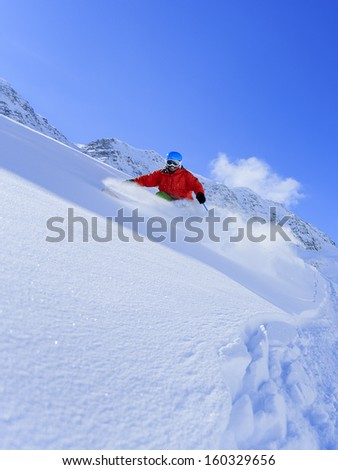 Skiing, Skier, Freeride in fresh powder snow - man skiing downhill #160329656