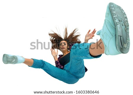 A second before falling. Caucasian young girl falling down in moment with bright emotions and facial expression. Female model in casual clothes. Shocked, scared, screaming. Copyspace for ad. #1603380646