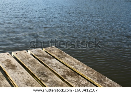 A wooden getty next to a tranquil river. Mindfulness and meditation background image.  #1603412107