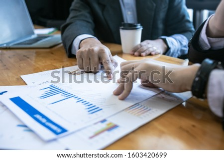 Image of two young businessmen using touchpad at meeting, Teamwork people concept.Horizontal, blurred background, flares  #1603420699