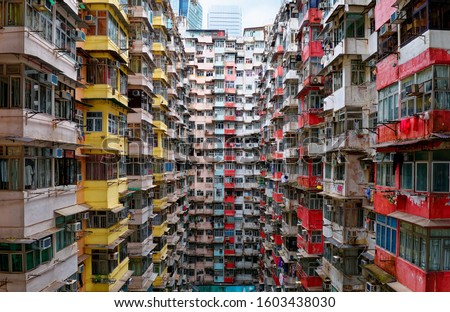 Overcrowded residential towers in a housing estate in Quarry Bay, Hong Kong~Crowded narrow apartments in a community in HK, an issue of high housing density  housing shortage due to overpopulation Royalty-Free Stock Photo #1603438030