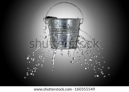 water is coming out of a bucket with holes #160355549