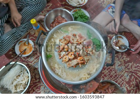 Blurred Picture Thai Barbecue (Moo Kratha) Buffet with Smoke. Cooking Barbecue Thai Style. Picture for Food Concept.