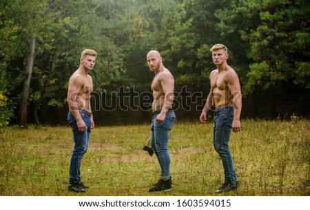 Little break. bodybuilders in jeans. Three sexy guys. brutal guys pose with naked torso. handsome guys with sexy body. Sports and leisure. mesomorph. three muscular men with axe. athletic man use ax. #1603594015
