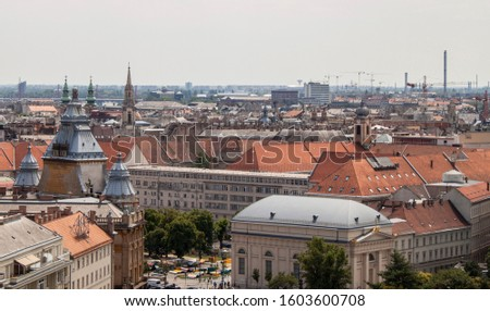 Deak Square from above, the city center of Budapest, Hungary. Rooftop view from the tower of St. Stephen's Basilica. Historical buildings, towers and colorful rooftops. European capital city skyline. #1603600708