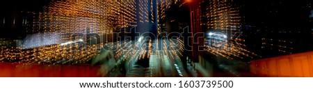 Zoom effect on lights bulb kept over the building. Motion blur with zoom effect. Zoom blur effect of lights. #1603739500