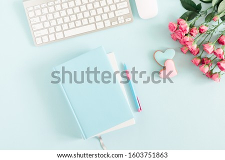Composition Valentine's Day. Female desktop сomputer keyboard, notepad, rose flowers, ginger cookie in shape heart on pastel blue background. Valentine day concept. Flat lay, top view, copy space #1603751863