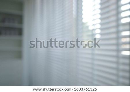 Blur focus of White venetian blinds.Blur focus of Blinds background with textures.Window blinds in the bedroom #1603761325