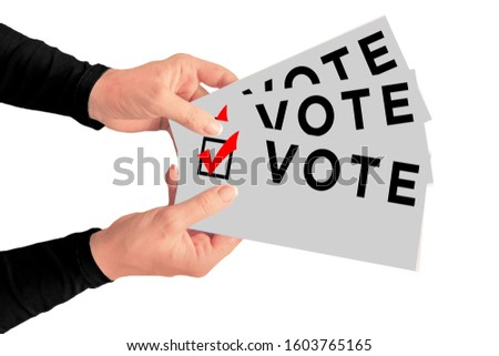Election bills with text vote and checked box in hands of middle aged woman. Concept of presidential or parliamentary elections and people choice #1603765165