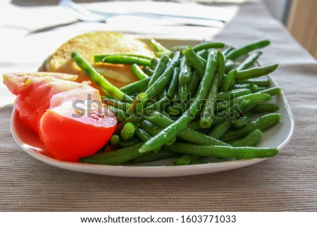 Camembert cheese with tomato and green beans #1603771033