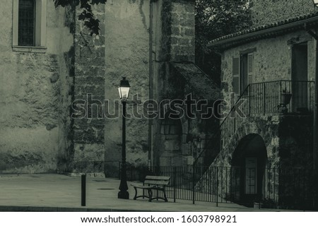 Black and white pic of a paceful square in little village of Provence, France
