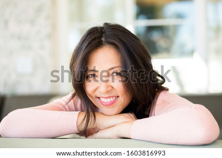 Portrait of an Asian woman smiling. #1603816993