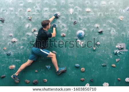 Man climbing on wall. Rock-climbing. Climbing icon. Climbing background. #1603850710