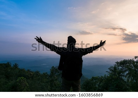 A man enjoy the scenic nature beauty of Kerala, Best place to visit in Kannur Vazhamala, Travel and Tourism Concept Image  #1603856869