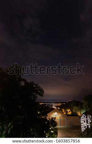 Szczecin. Night view from across the river to the illuminated historic center. Odra river. Chrobry embankments in Szczecin Royalty-Free Stock Photo #1603857856