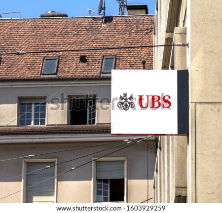 Basel, Switzerland - July, 1 2019: UBS sign on the wall of an UBS office building. UBS is a Swiss global financial services bank, headquartered in the Swiss city of Zurich. #1603929259