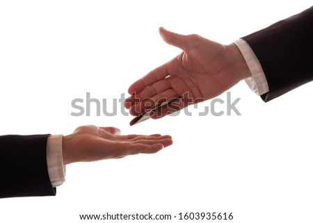 A businessman puts several notes to another man between his fingers #1603935616
