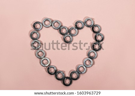 Heart of steel Grover washers on a pink background #1603963729