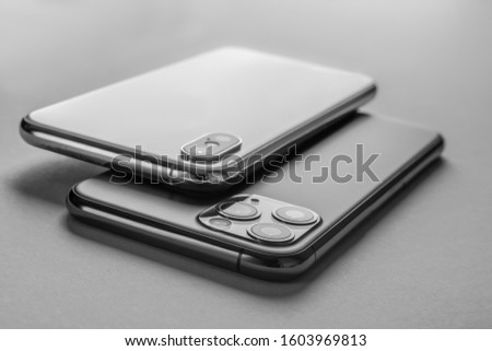 Close up of different mobile phones. Black and white photo #1603969813