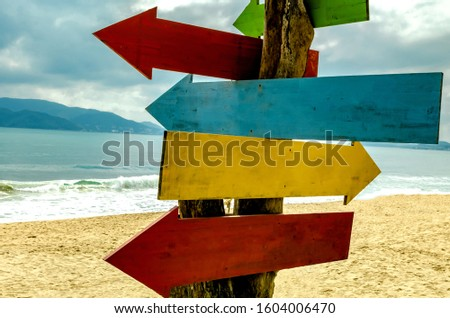 Wooden pointers on the beach. Happy new year 2020 at sea. No signposts for creative ideas. #1604006470