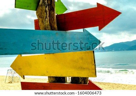 Wooden pointers on the beach. Happy new year 2020 at sea. No signposts for creative ideas. #1604006473
