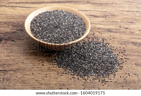 Chia Seeds in a wooden bowl on wooden background #1604019175