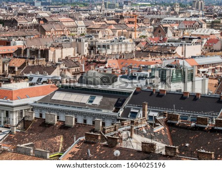 Skyline of Budapest, Hungary. Rooftop view from the tower of St. Stephen's Basilica. Buildings, towers and colorful rooftops. European capital city skyline. #1604025196