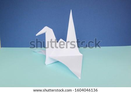 A white origami paper Crane  #1604046136
